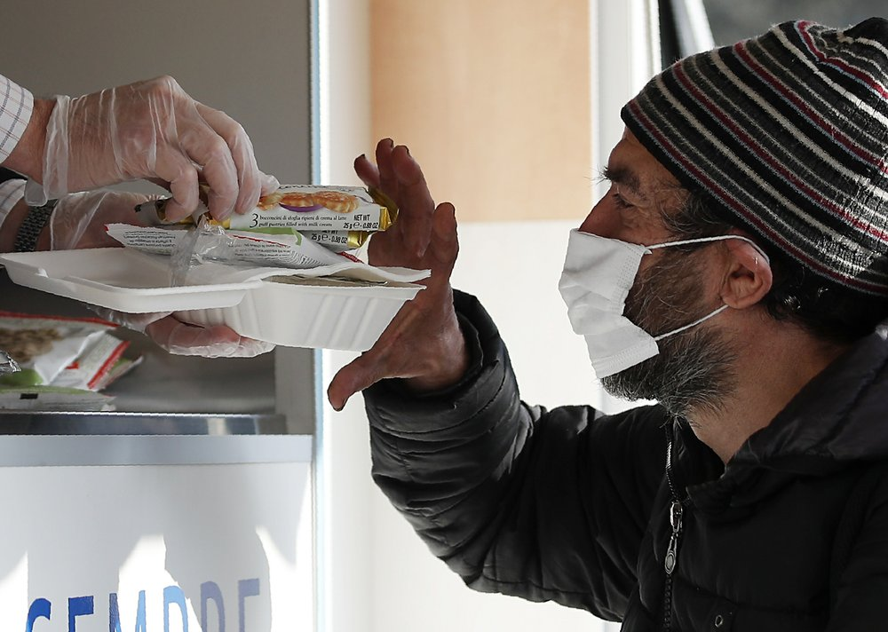 The Latest: Italy hits record number of daily coronavirus cases at 39,800