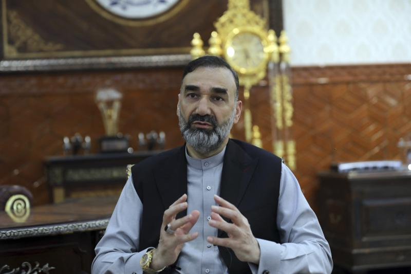 """Ata Mohammad Noor, chief of Jamiat-e-Islami and a powerful northern warlord, speaks during an interview with the Associated Press at his house in Mazar-e-Sharif north of Kabul, Afghanistan, Thursday, July 8, 2021. One of the most powerful warlords of northern Afghanistan and a key US ally in the 2001 defeat of the Taliban blames a fractious Afghan government and an """"irresponsible"""" American departure for a swift series of recent Taliban gains across the north. (AP Photo/Rahmat Gul)"""