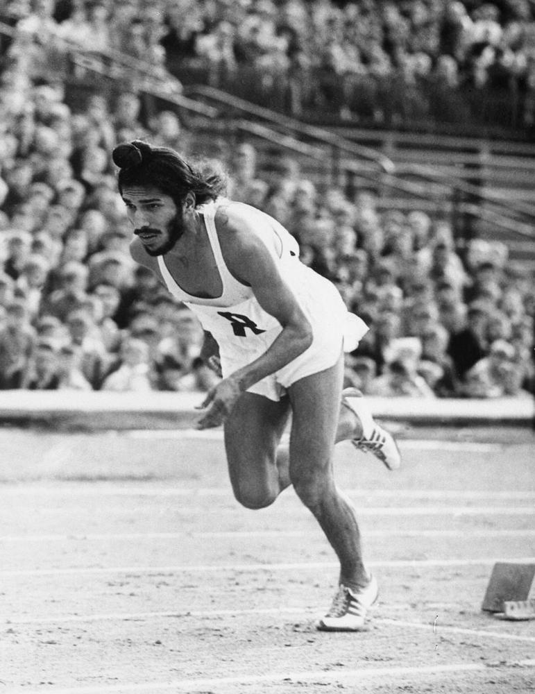In this June 20, 1961, file photo, Milkha Singh, the famed Indian middle-distance runner, starts the 400 metres race in the Janusz Kusocinski Memorial Track and Field MeetinG, in Warsaw, Poland. Singh, one of India's first sport superstars and ace sprinter who overcame a childhood tragedy to become the country's most celebrated athlete, has died. He was 91. Singh's family said he died late Friday, June 18, 2021, of complications from COVID-19 in a hospital in the northern city of Chandigarh.