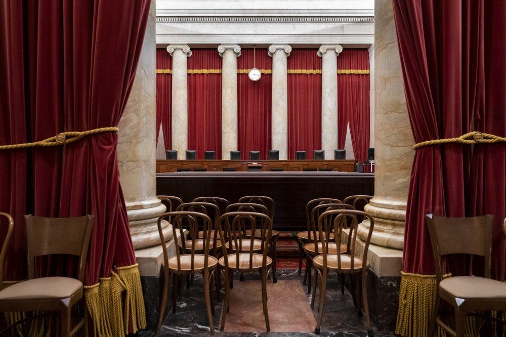 Supreme Court new attire: Black robes or bathrobes?