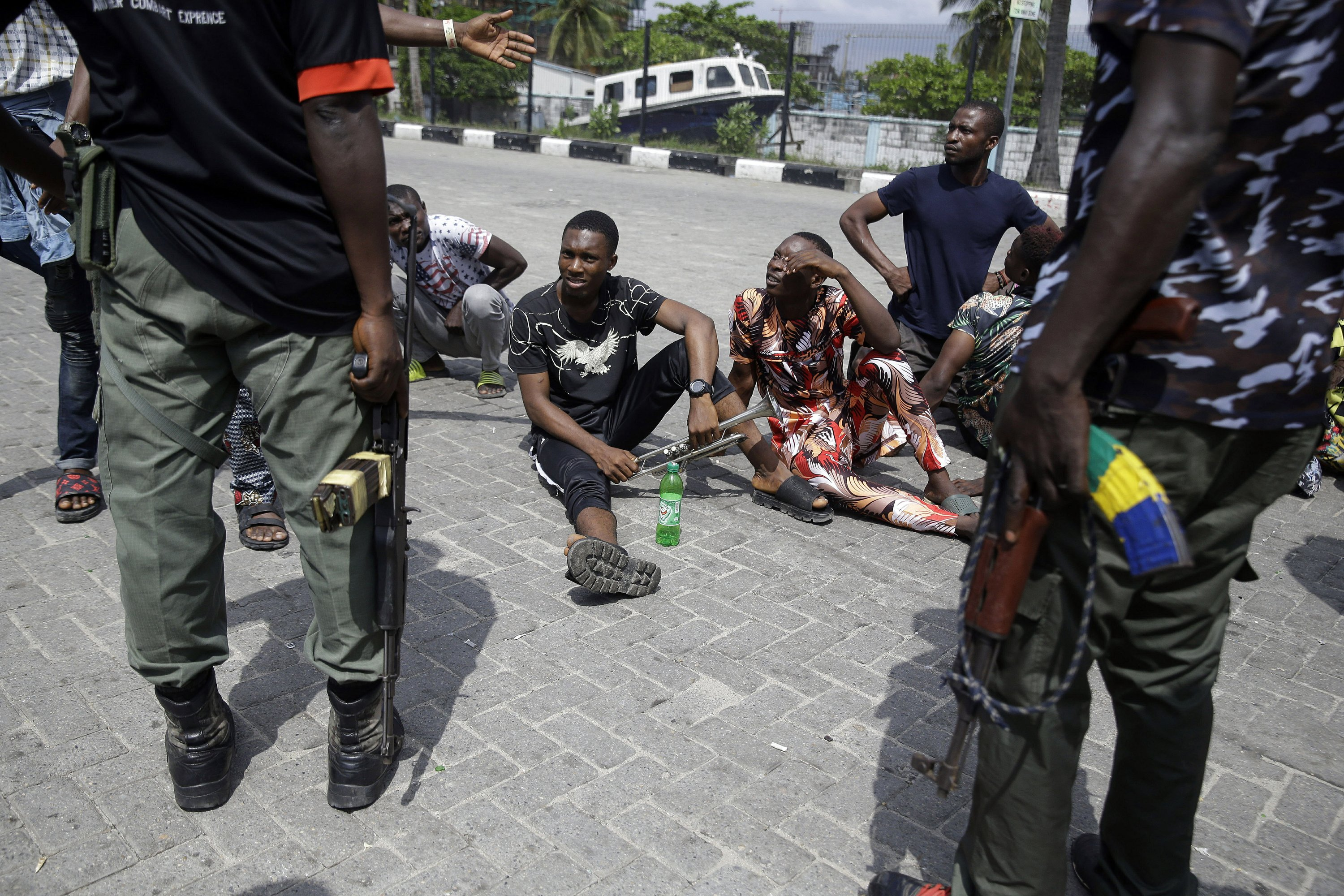 Nigeria says 51 civilians and 18 security forces have been killed in unrest following protests over police abuses. President Muhammadu Buhari blames 'hooliganism' and says authorities used 'extreme restraint,' comments which could further inflame tensions.