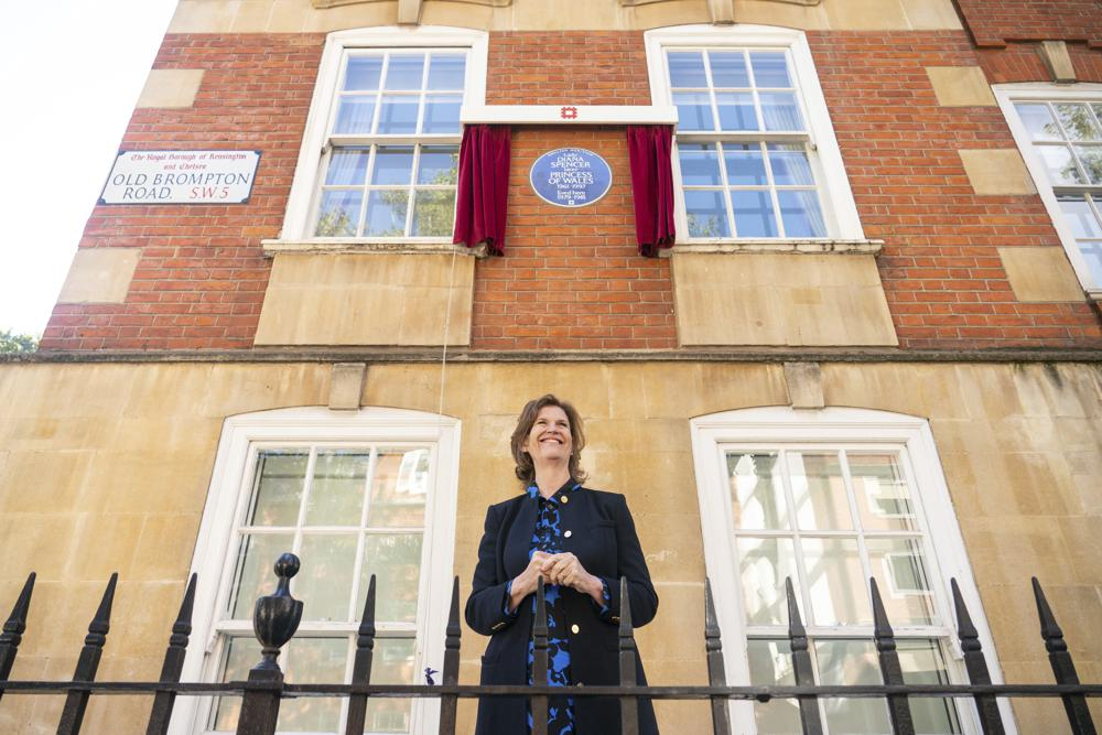 Princess Diana's former flatmate Virginia Clarke stands outside Coleherne Court, Old Brompton Road, London, Wednesday Sept. 29, 2021, during the unveiling of the English Heritage blue plaque. London finally honored the late Princess Diana with a blue plaque at the place she called home in the two years before she married Prince Charles and her life in the goldfish bowl began. (Dominic Lipinski/PA via AP)