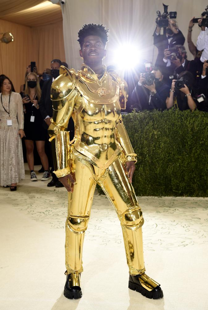 """Lil Nas X attends The Metropolitan Museum of Art's Costume Institute benefit gala celebrating the opening of the """"In America: A Lexicon of Fashion"""" exhibition on Monday, Sept. 13, 2021, in New York. (Photo by Evan Agostini/Invision/AP)"""