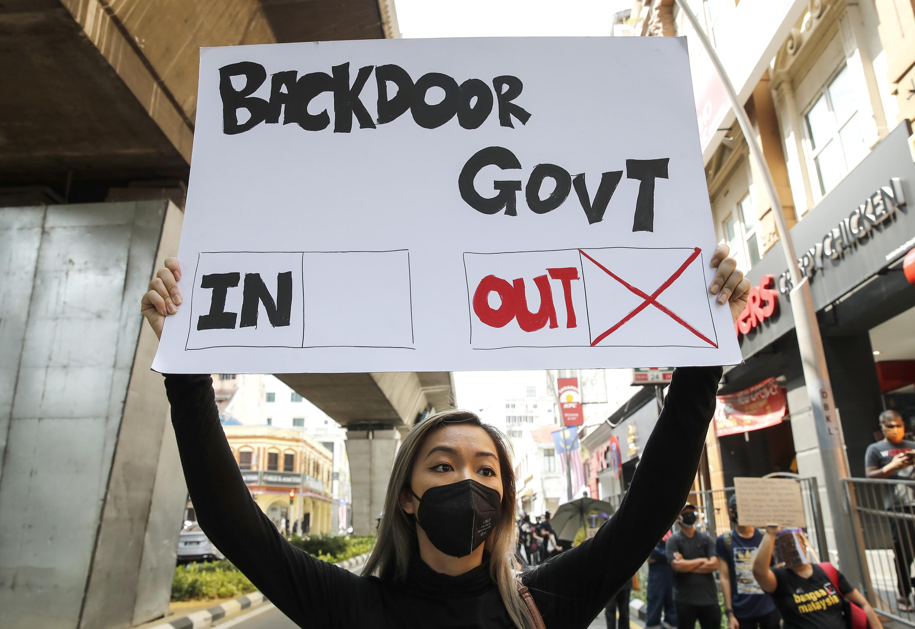 Malaysian youths demand PM quit as pandemic worsens