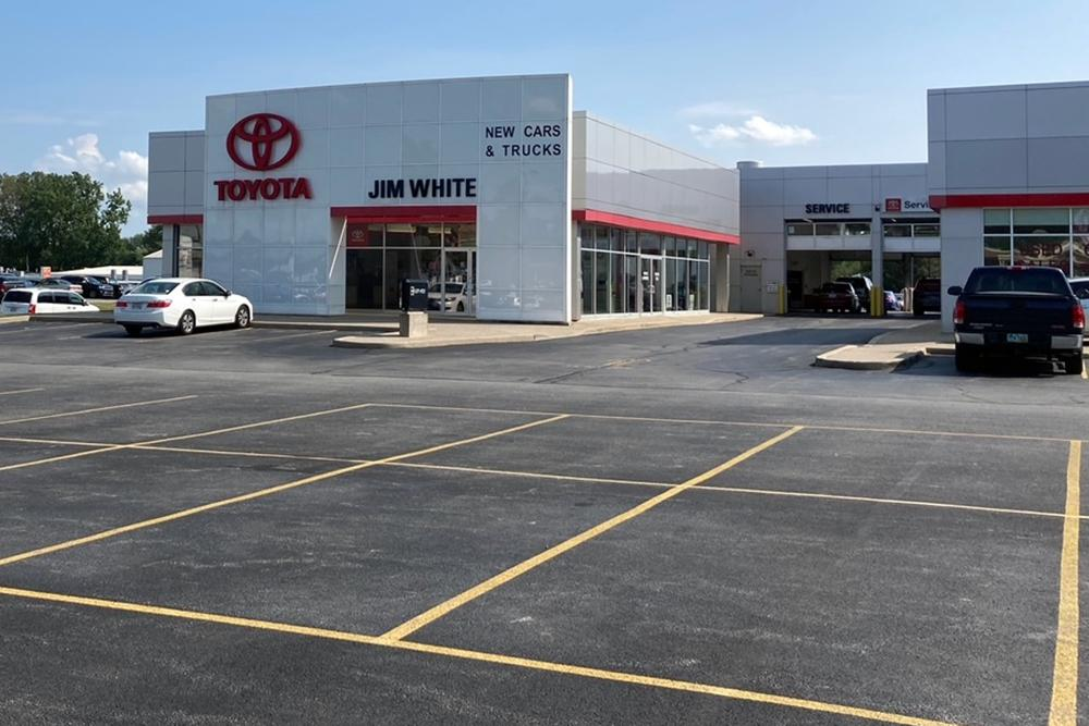 The new car lot at the Jim White Toyota just outside of Toledo, Ohio, is depleted on Friday, Aug. 27, 2021, with only a few new vehicles available for sale. A global shortage of computer chips has forced automakers to temporarily close factories, limiting production and driving up prices. The coronavirus delta variant is now causing shortages of other parts. (AP Photo/Tom Krisher)