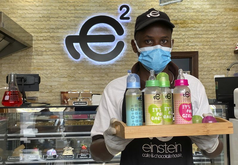 New Trend in Gulf Arab: cafes selling coffee and other cold drinks in baby bottles; sparks excitement, confusion, backlash