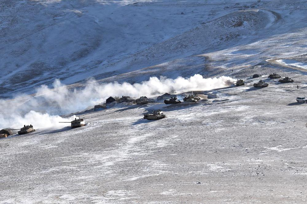 In this Feb. 10, 2021, file photo provided by the Indian Army, tanks pull back from the banks of Pangong Tso lake region, in Ladakh along the India-China border. The foreign ministers of India and China have met in Tajikistan, Wednesday, July 14, 2021 with New Delhi stressing that a military standoff along a mountainous border area is profoundly disturbing their ties, and warning that any unilateral change in the status quo by Beijing is unacceptable. Indian External Affairs Minister S. Jaishankar said in a tweet that a full restoration and maintenance of peace and tranquility in border areas is essential for the development of bilateral ties.