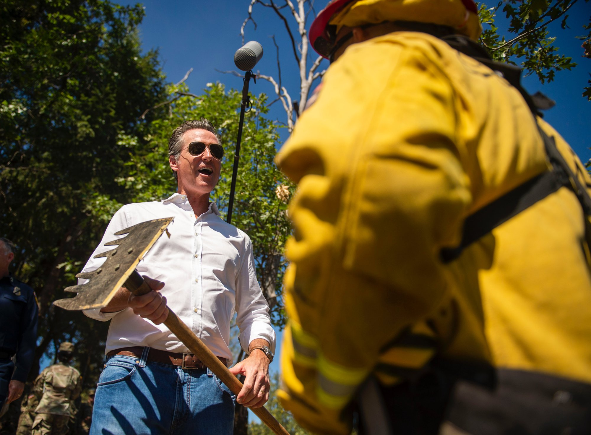 California governor defends wildfire efforts, jabs at feds