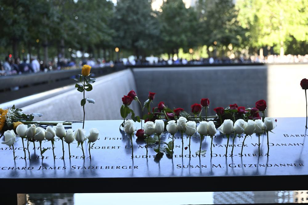 Flowers are seen at the National September 11 Memorial in New York on the 20th anniversary of the attacks, Saturday, Sept. 11, 2021. .(David Handschuh/Pool Photo via AP)