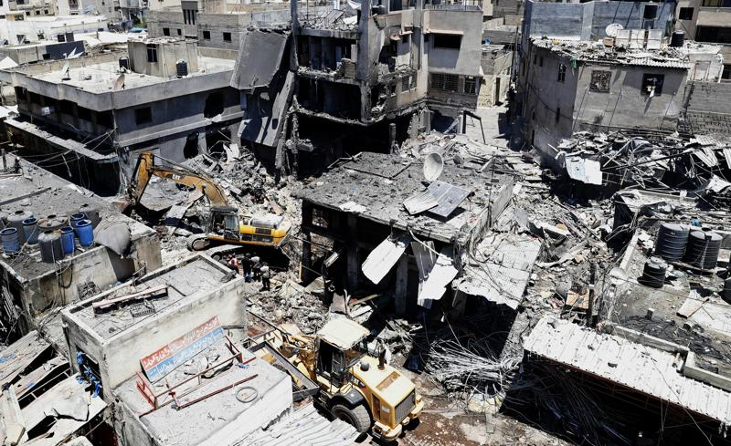Palestinian rescuers and security personnel work at the scene of an explosion in the Al-Zawiya market area of Gaza City, Gaza, Thursday, July 22, 2021. At least one person was killed and some 10 injured Thursday when the explosion tore through a house in a popular market, the interior ministry said. (AP Photo/Adel Hana)