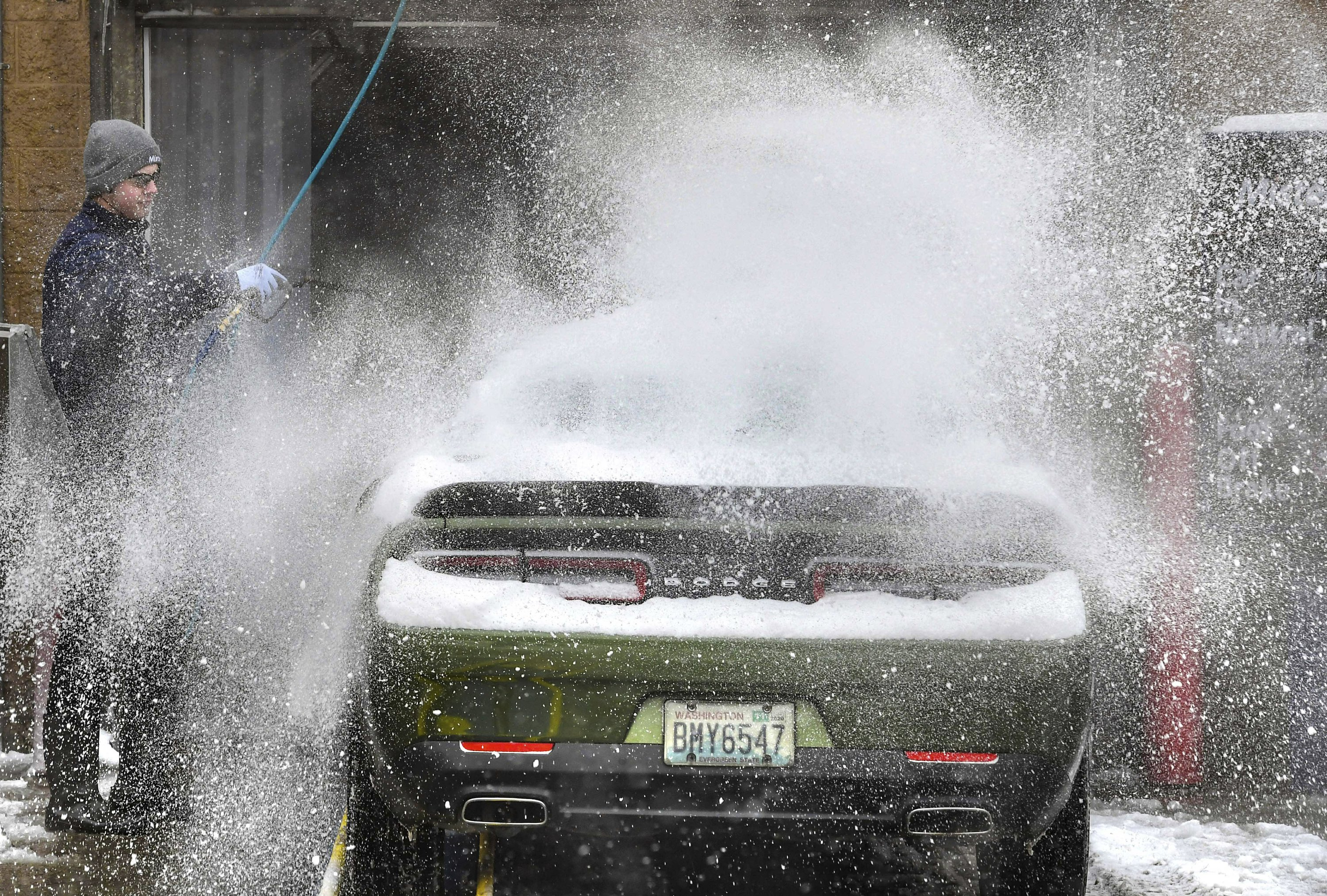 Northwest hit with more snow, wind, power outages, 2 rescued