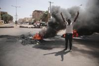 People burn tires during a protest a day after the military seized power Khartoum, Sudan, Tuesday, Oct. 26, 2021. The takeover came after weeks of mounting tensions between military and civilian leaders over the course and the pace of Sudan's transition to democracy. (AP Photo/Marwan Ali)