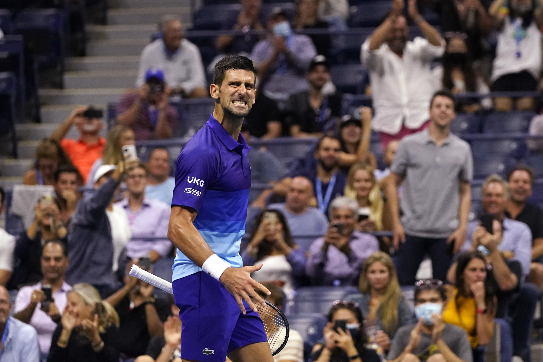 Set down, Djokovic tops Berrettini at Open, nears year Slam - Associated Press
