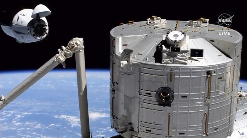 Recycled SpaceX capsule delivers new crew to space station