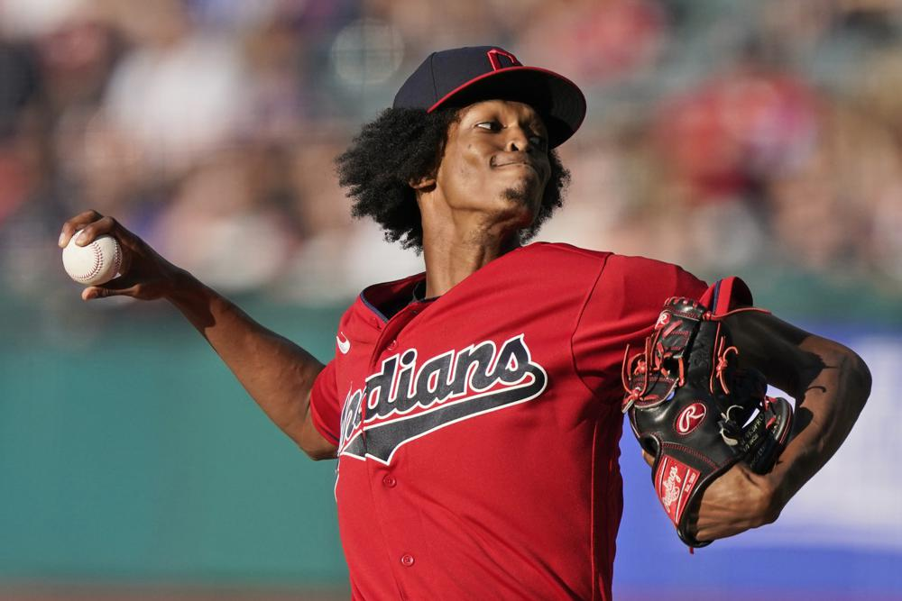 Cleveland Indians starting pitcher Triston McKenzie delivers in the first inning of a baseball game against the Kansas City Royals, Friday, July 9, 2021, in Cleveland. (AP Photo/Tony Dejak)