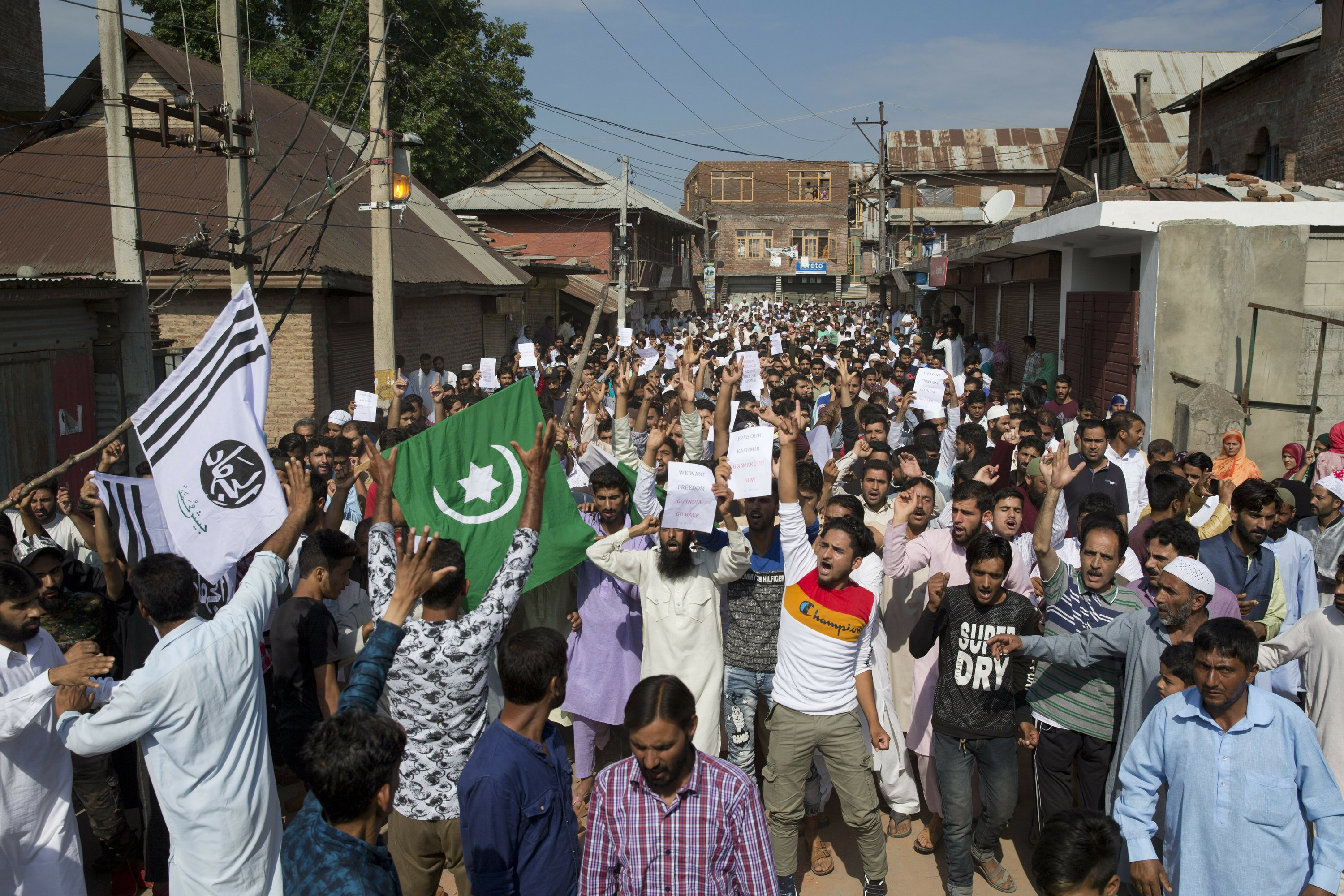 Troops let some Muslims go to mosques in locked-down Kashmir
