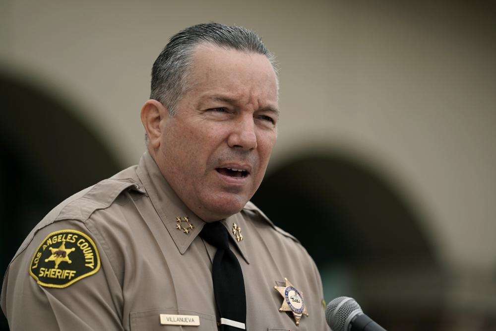 FILE - In this Sept. 10, 2020, file photo Los Angeles County Sheriff Alex Villanueva speaks at a news conference in Los Angeles. Villanueva says he will not enforce the county's vaccine mandate in his agency. Villanueva, who oversees the largest sheriff's department in the county with roughly 18,000 employees, said Thursday, Oct. 7, 2021, in a Facebook Live event that he does not plan to carry out the county's mandate, under which Los Angeles County employees had to be fully vaccinated by Oct. 1, 2021. (AP Photo/Jae C. Hong,File)