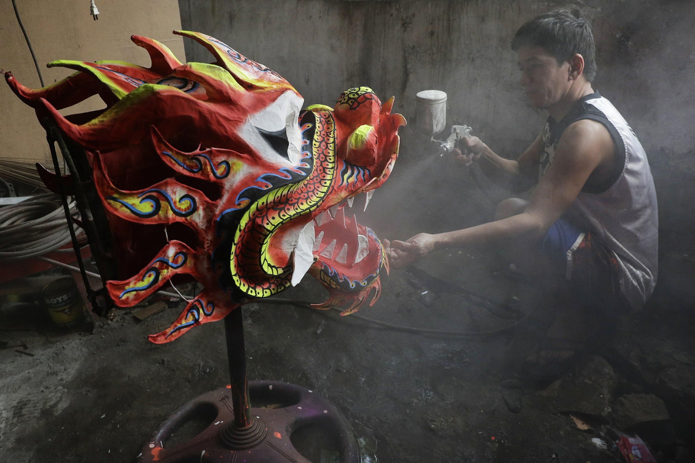 AP PHOTOS: Dragon dance ban saddens Manila residents