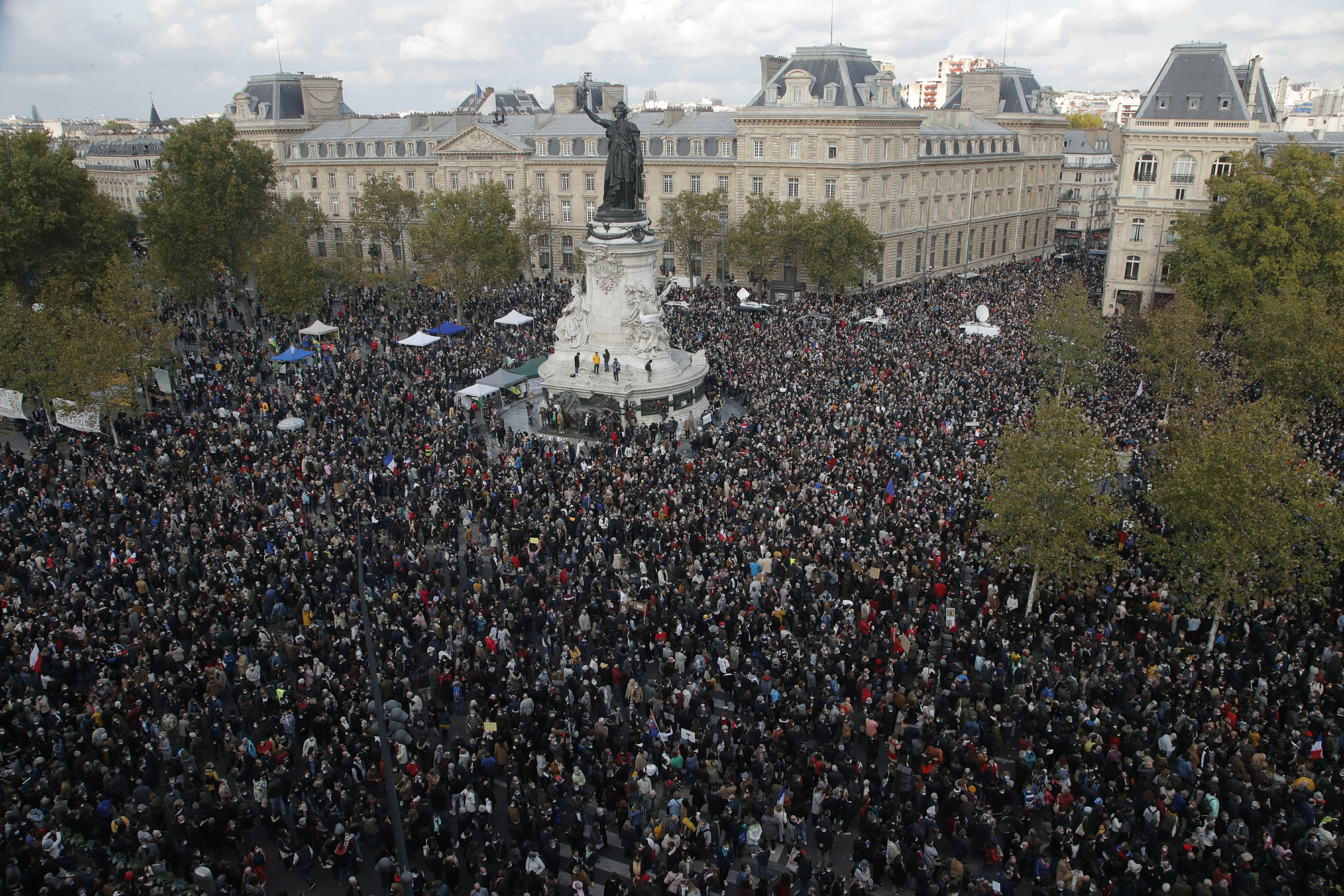 PARIS (AP) — France's prime minister joined demonstrators on Sunday who rallied together across the country in tribute to a history teacher who was beheaded near Paris after discussing caricatures...