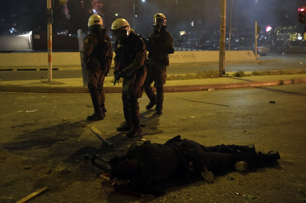 Youths protesting police violence attack Athens police station