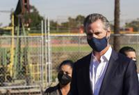 California Gov. Gavin Newsom speaks near oil fields by the Wilmington Boys & Girls Club Thursday, Oct. 21, 2021, in Wilmington, Calif. California's oil and gas regulator on Thursday proposed that the state ban new oil drilling within 3,200 feet of schools, homes and hospitals to protect public health in what would be the nation's largest buffer zone between oil wells and communities (Hunter Lee/The Orange County Register via AP)