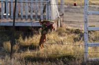 A bouquet of flowers is left to honor cinematographer Halyna Hutchins outside the Bonanza Creek Ranch in Santa Fe, N.M., Sunday, Oct. 24, 2021. Hutchins died after actor Alec Baldwin fired a fatal gunshot from a prop gun that he had been told was safe. (AP Photo/Jae C. Hong)