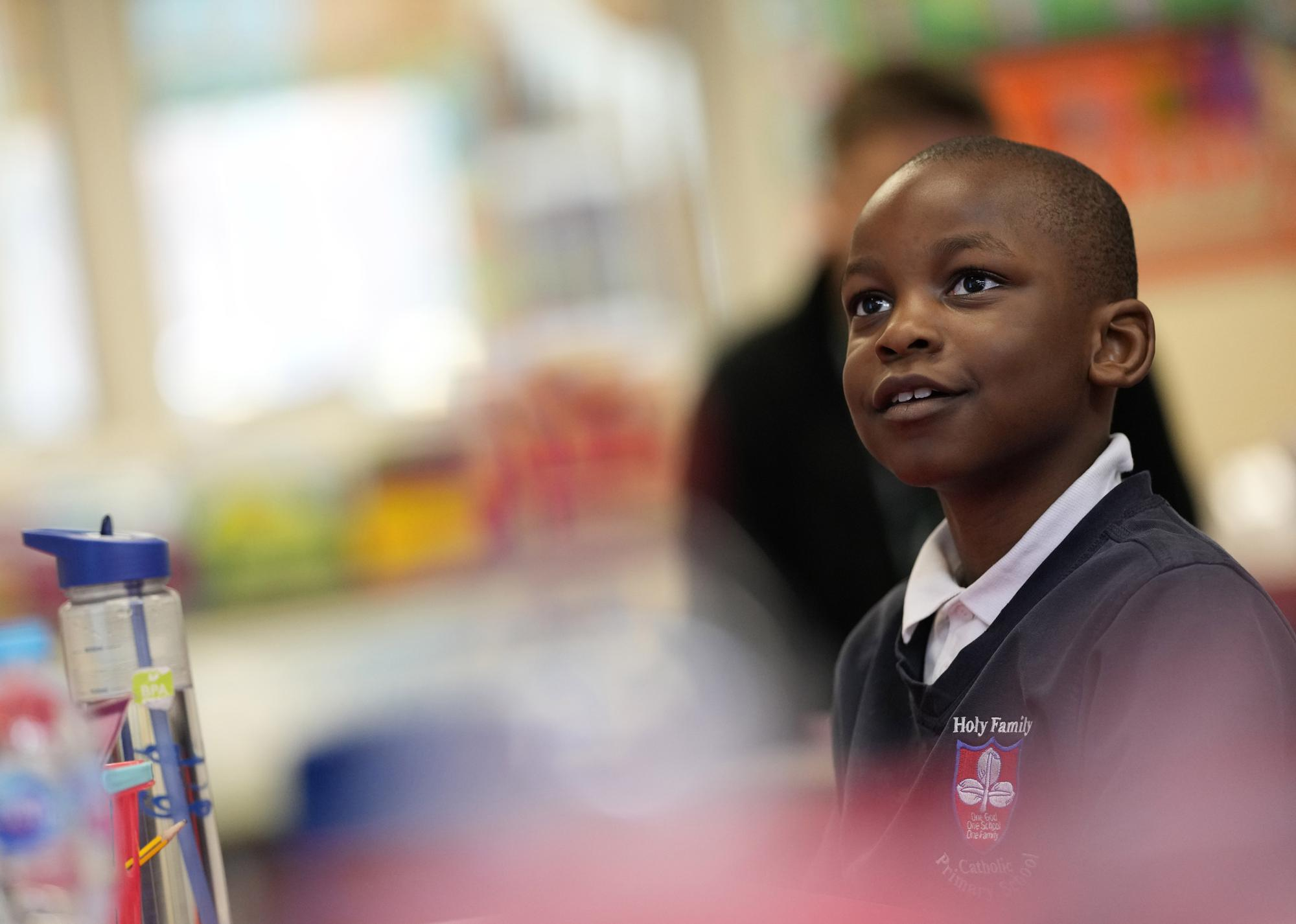 Noah Popula listens to his teacher during a year 2 lesson at the Holy Family Catholic Primary School in Greenwich, London, Thursday, May 20, 2021. (AP Photo/Alastair Grant)