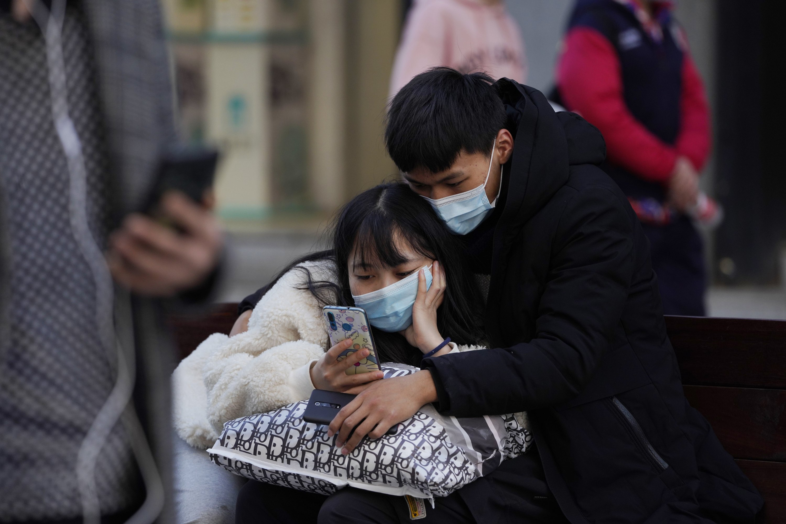 apnews.com: Asia Today: China virus cases spike as WHO researchers visit