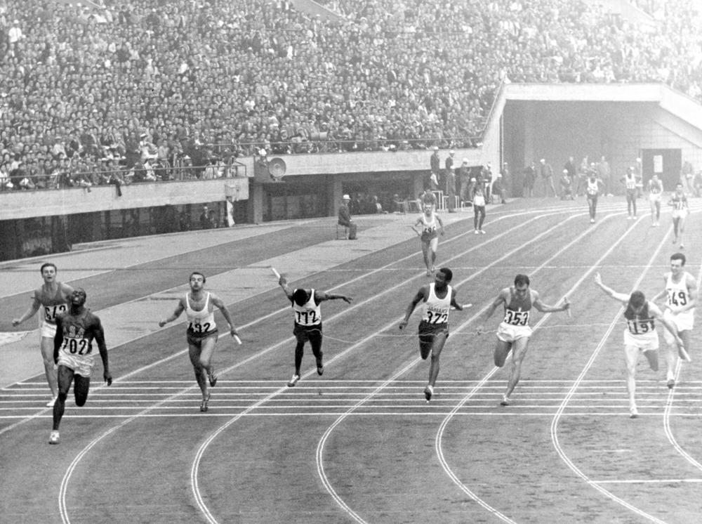 This Oct. 21, 1964, file photo shows the finish scene of men's 4 x100 meter relay finals at the National Stadium in Tokyo. From left are B. Savchuk, of Soviet Union, Bob Hayes, of U.S., winner, M. Dudzuak, of Poland, second, H. Herrerfa Fucil, of Venezuela, D.O. Johnson, of Jamaica, P. Gionnattasio, of Italy, J. Delecour, of France, third, and L. Davies of Britain. (AP Photo, File)