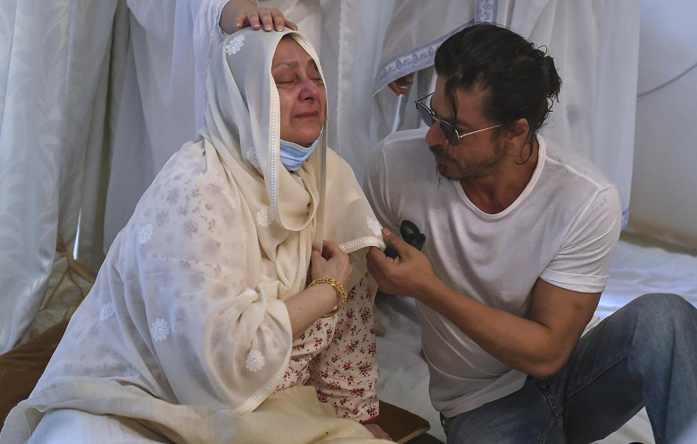 """Actor Shahrukh Khan, right, consoles Saira Banu as she mourns death of her husband and Bollywood icon Dilip Kumar at their residence in Mumbai, India, Wednesday, July 7, 2021. Dilip Kumar, hailed as the """"Tragedy King"""" and one of Hindi cinema's greatest actors, died Wednesday in a Mumbai hospital after a prolonged illness. He was 98."""