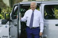 President Joe Biden smiles after driving a Jeep Wrangler 4xe Rubicon on the South Lawn of the White House in Washington, Thursday, Aug. 5, 2021, during an event on clean cars and trucks. (AP Photo/Susan Walsh)
