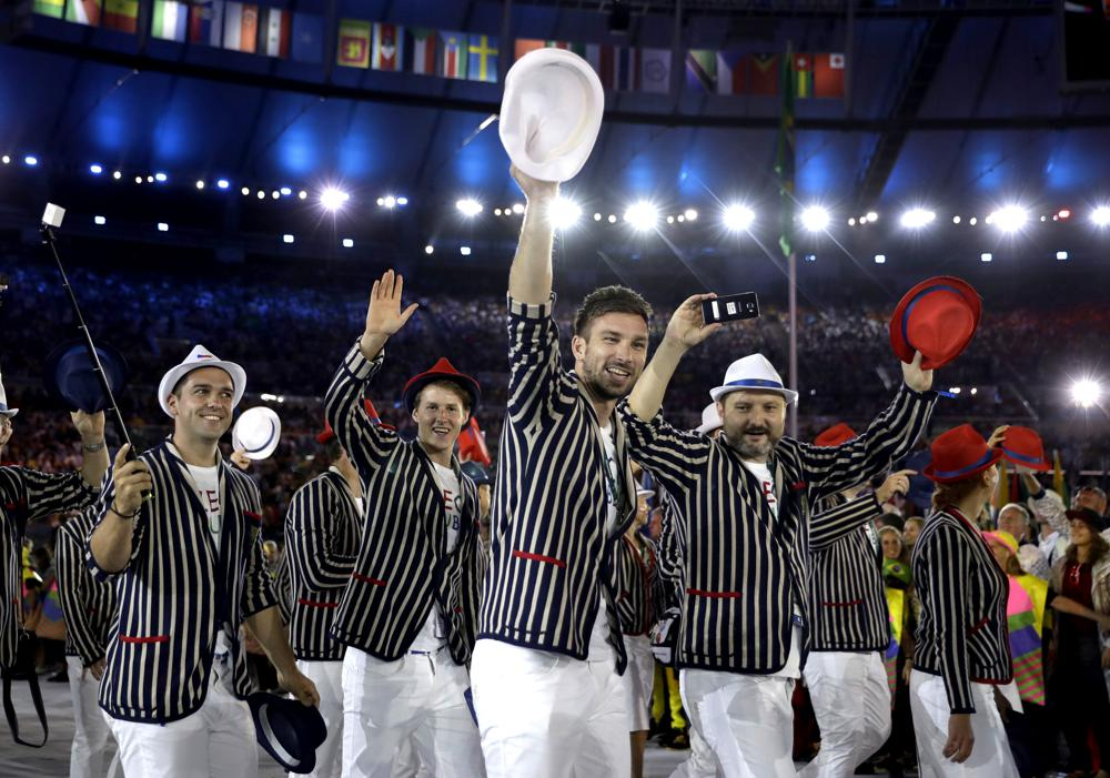 """FILE - Team Czech Republic arrives during the opening ceremony for the Summer Olympics in Rio de Janeiro, Brazil on Aug. 5, 2016. Olympic gear makes for lively social media fodder, starting with the hours-long Parade of Nations. The year's wait due to the pandemic has given enthusiasts extra time to ponder what they love or hate. There's the Czech Republic and its """"Beetlejuice"""" stripes in Rio 2016. (AP Photo/David J. Phillip, File)"""