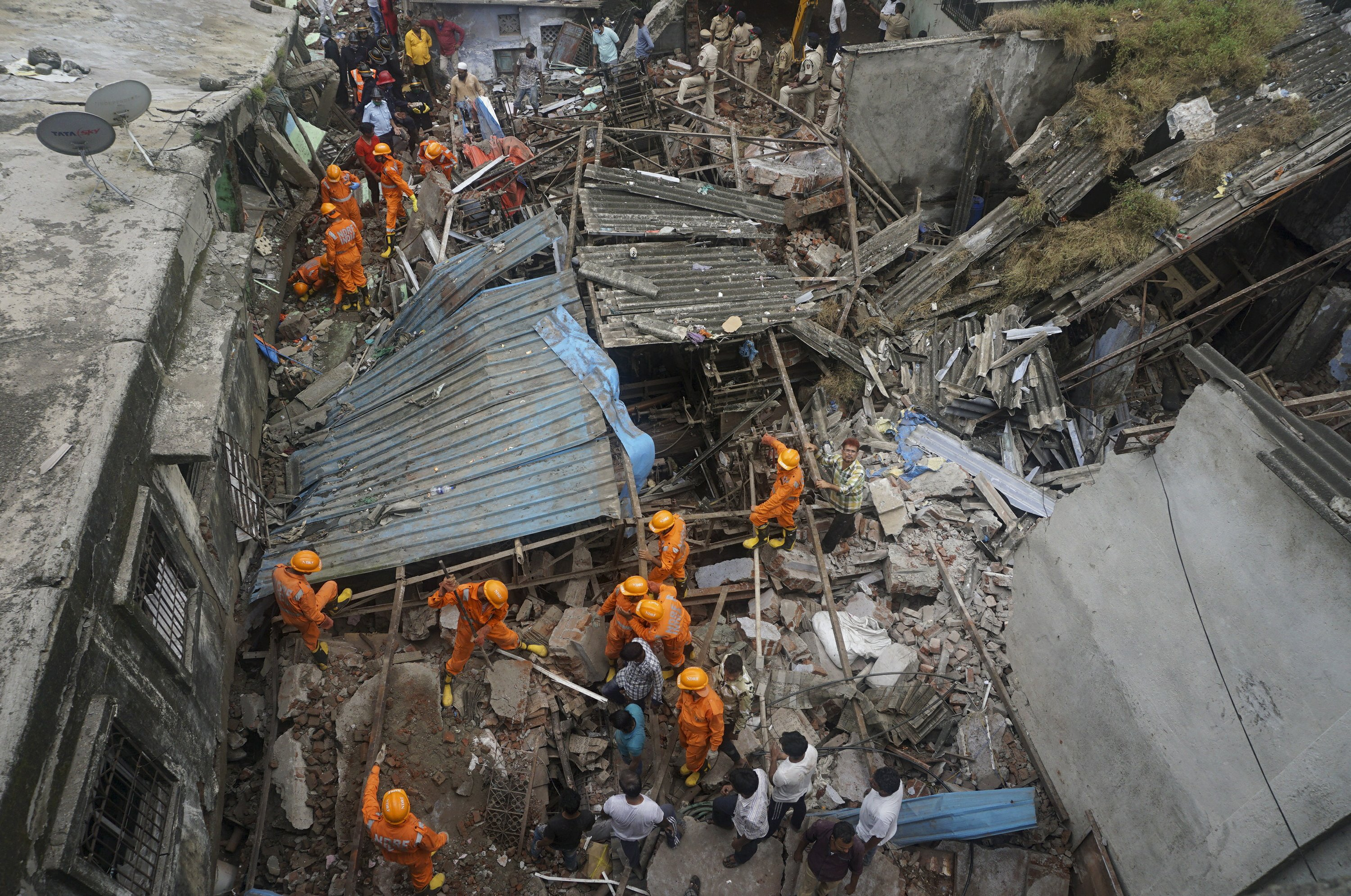 At least 8 dead in residential building collapse in India