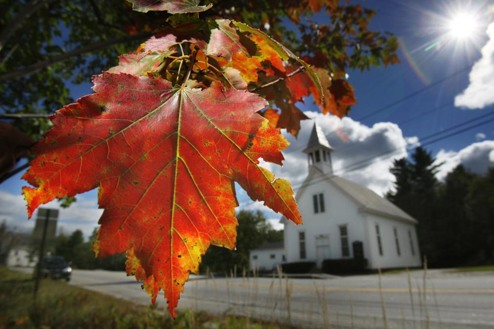 FILE - In this Sept. 17, 2010 file photo, a maple tree shows its fall colors in Woodstock, Maine. Recent leaf-peeping seasons have been disrupted by weather conditions in New England, New York and elsewhere. Arborists and ecologists say the trend is likely to continue as the planet warms. (AP Photo/Robert F. Bukaty, File)