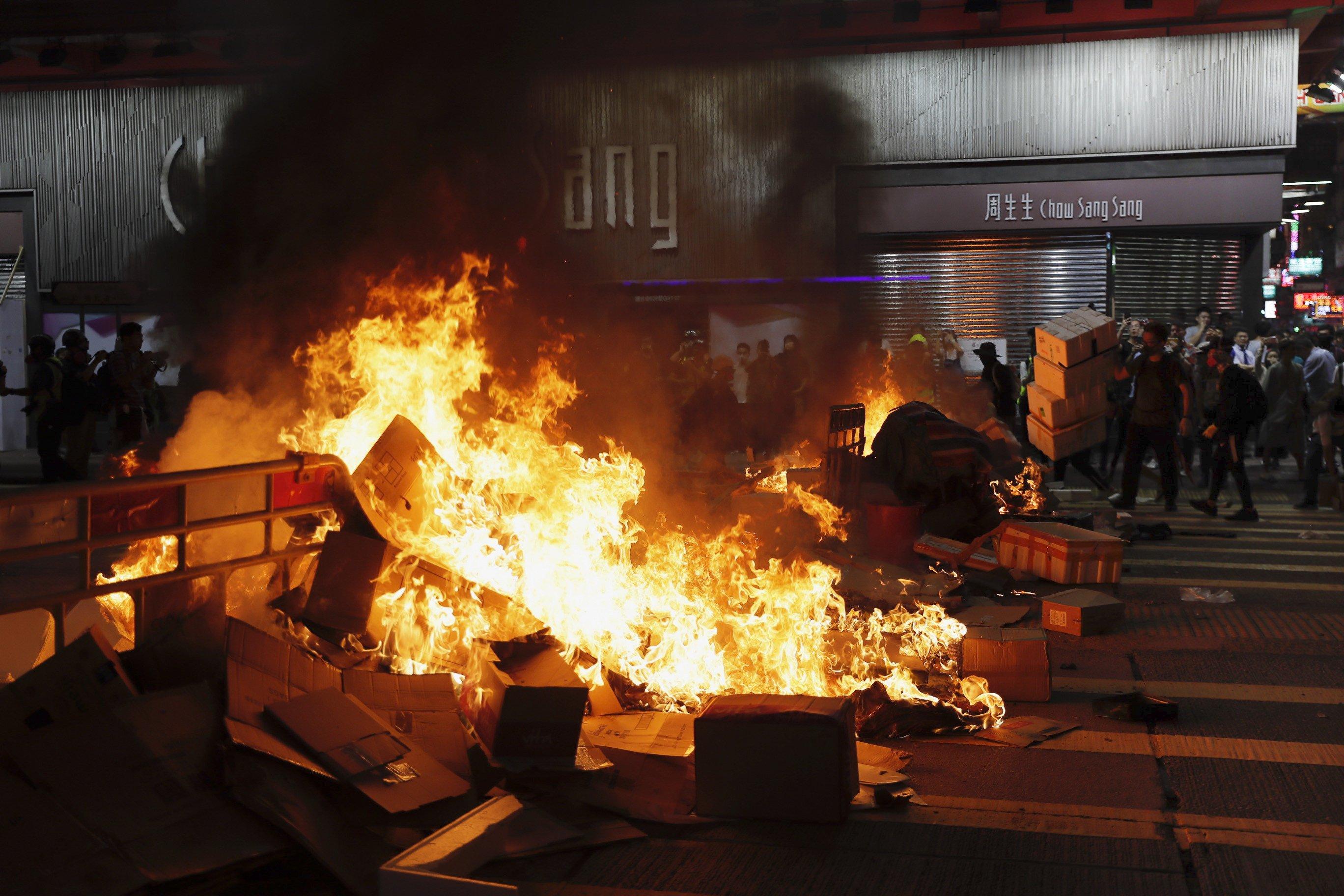 Protests flare in Hong Kong despite bill's withdrawal