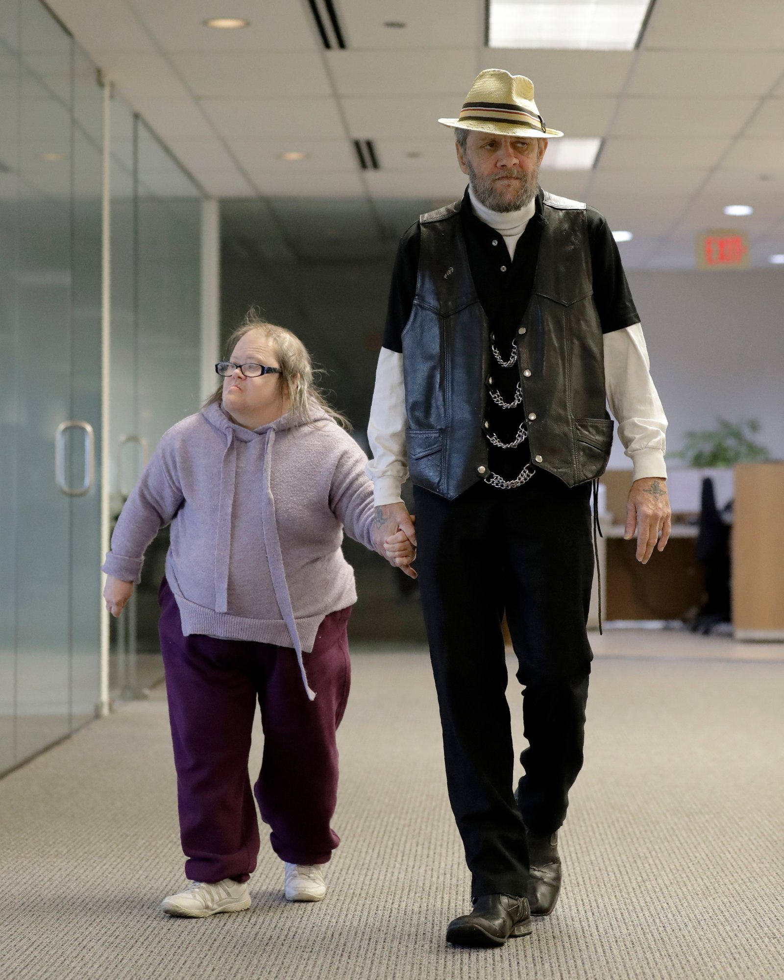 In this Saturday, Dec. 21, 2019 photo, Bobby Goldberg and his sister Debbie arrive at the office of his lawyer, Melissa Anderson, in Bannockburn, Ill. Goldberg has filed a lawsuit claiming he was abused more than 1,000 times in multiple states and countries by the late Donald McGuire, a prominent American Jesuit priest who had close ties to Mother Teresa. (AP Photo/Nam Y. Huh)