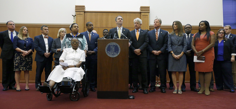 After massacre, Virginia governor demands action on guns
