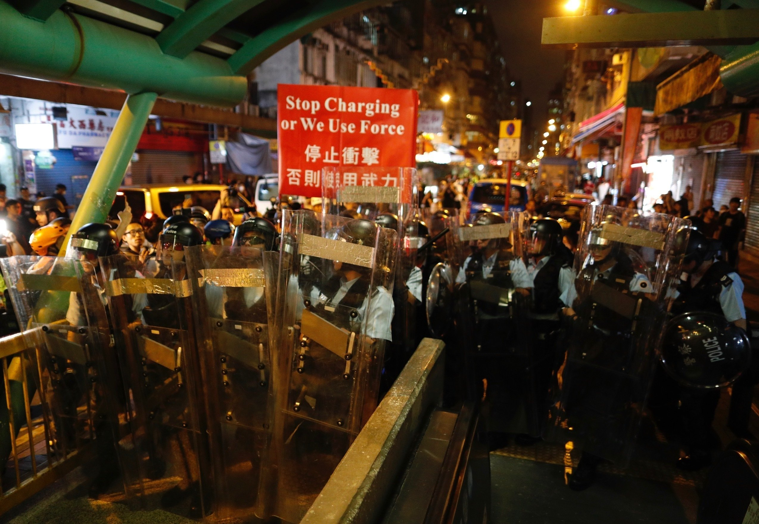 The Latest: Hong Kong fire tear gas at demonstrators