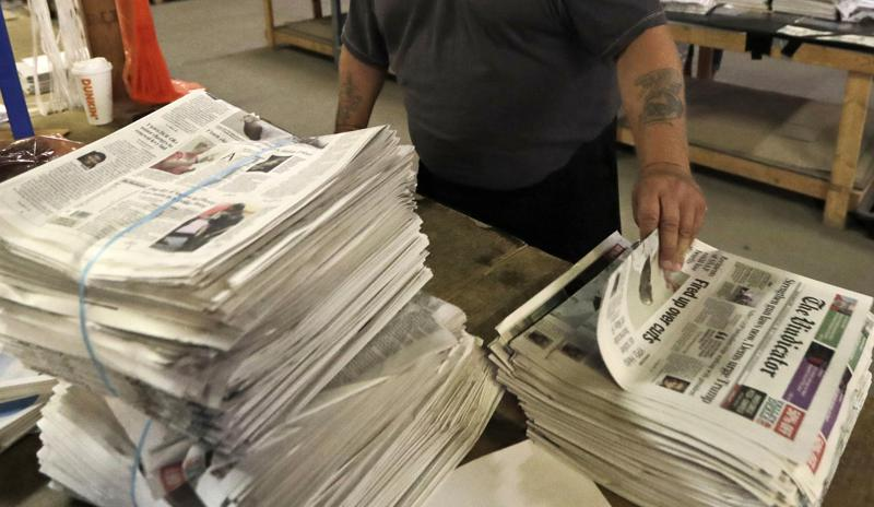 FILE - An employee sorts newspapers for delivery at a distribution center in Liberty Township near Youngstown, Ohio, on Aug. 6, 2019. Pew Research Center data released this week showed that 2020 was the first year that the newspaper industry earned more money from circulation than advertising, (AP Photo/Tony Dejak, File)