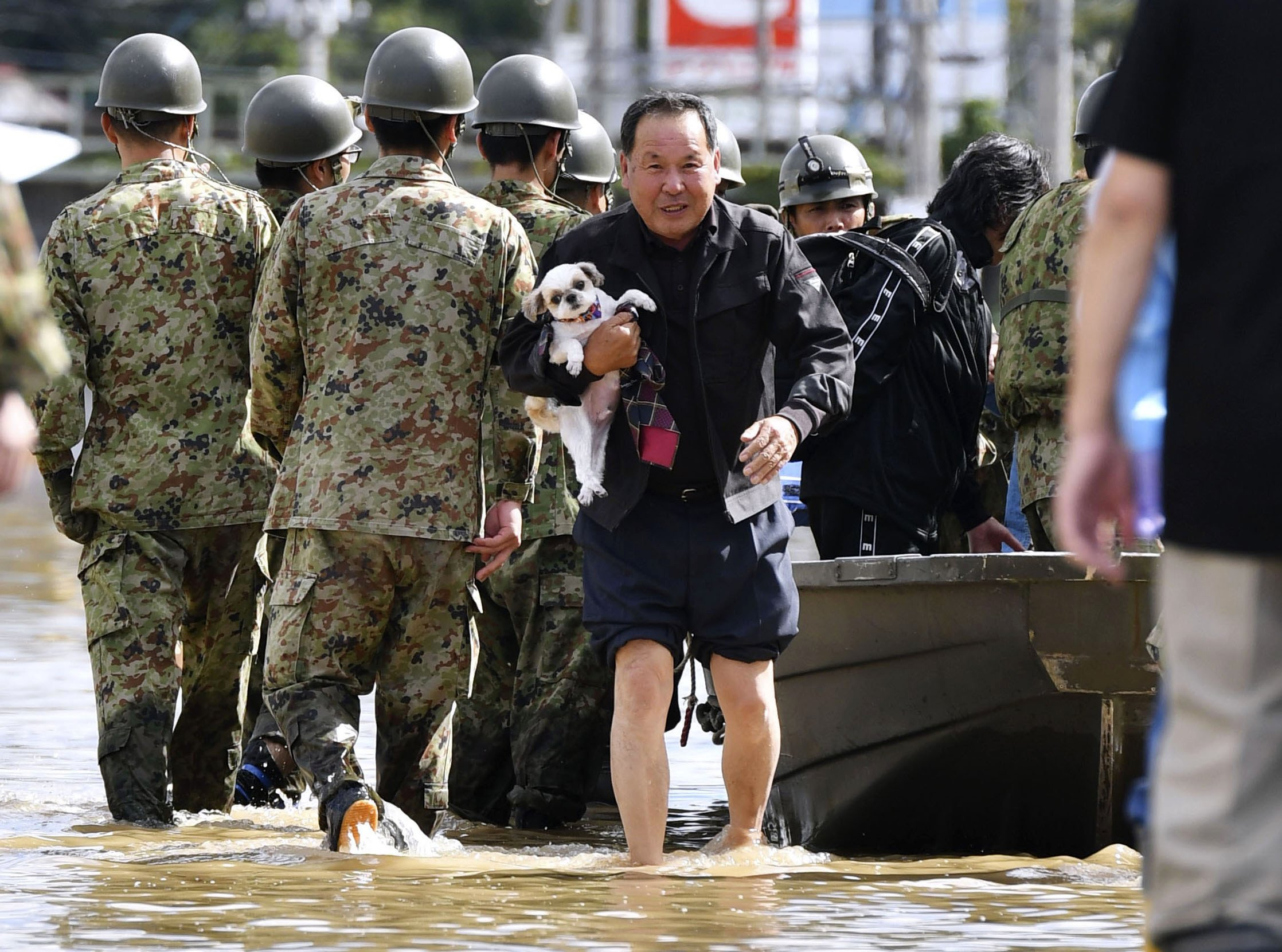 Typhoon leaves as many as 33 dead as Japan continues rescue