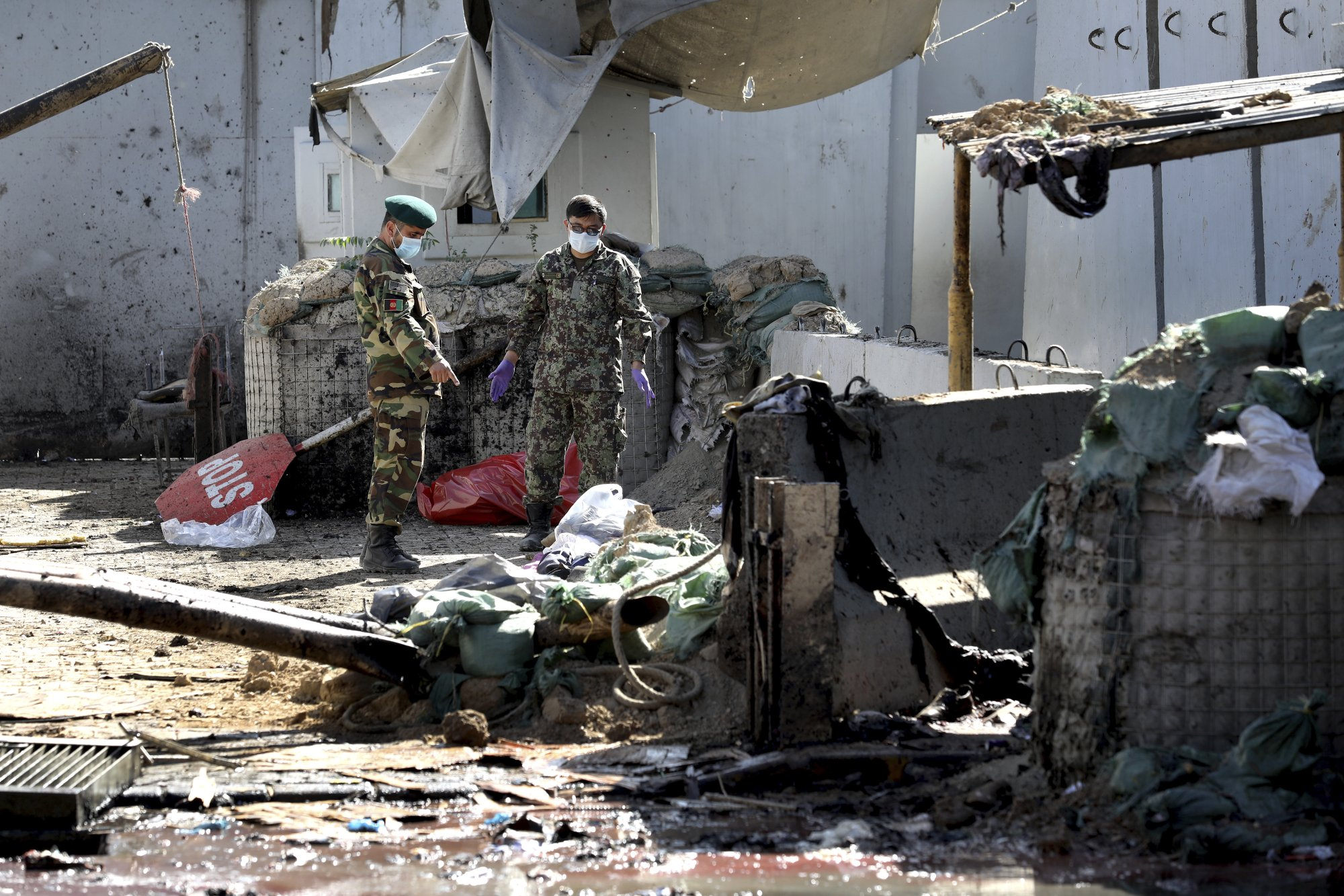 The Latest: Official says at least 22 killed in Kabul attack