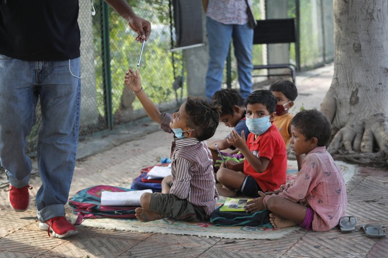 Indian Couple Run Street-Side Classes for Poor Students