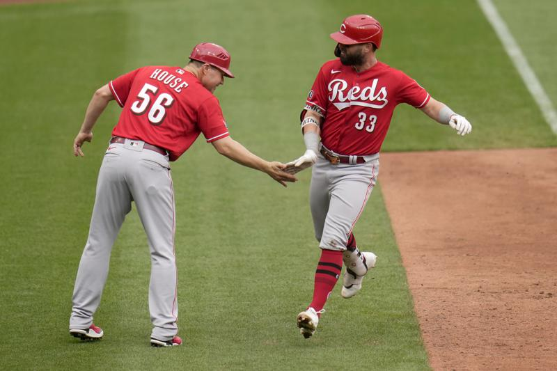 Cincinnati Reds' Jesse Winker (33) is congratulated by third base coach J.R. House after hitting a solo home run during the ninth inning of a baseball game against the St. Louis Cardinals Sunday, June 6, 2021, in St. Louis. (AP Photo/Jeff Roberson)