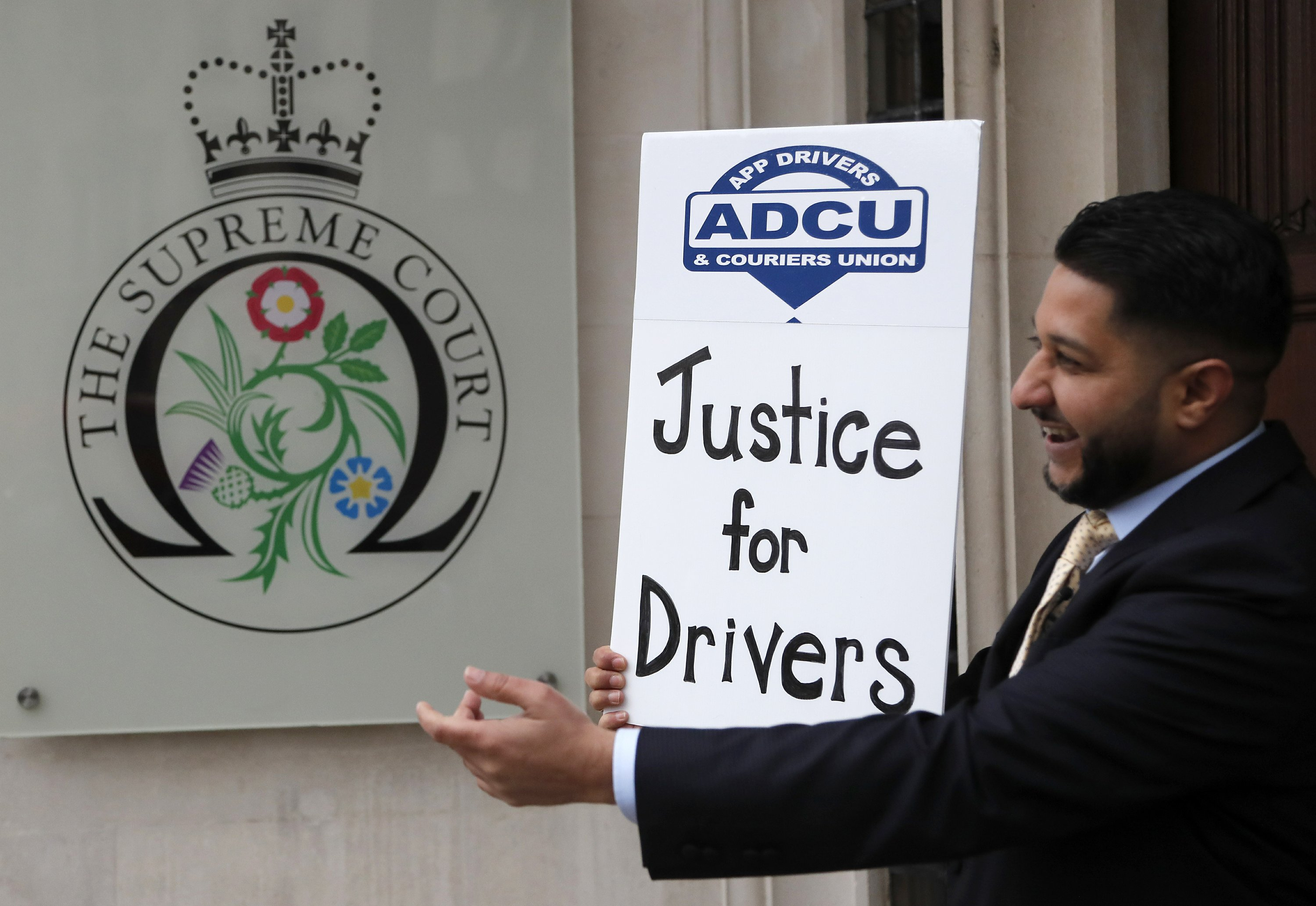 UK top court gives Uber drivers benefits in landmark ruling – The Associated Press