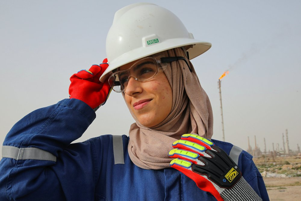In oil-rich Iraq, a few women turn their backs on dreary office jobs often given to women to take on rig site jobs