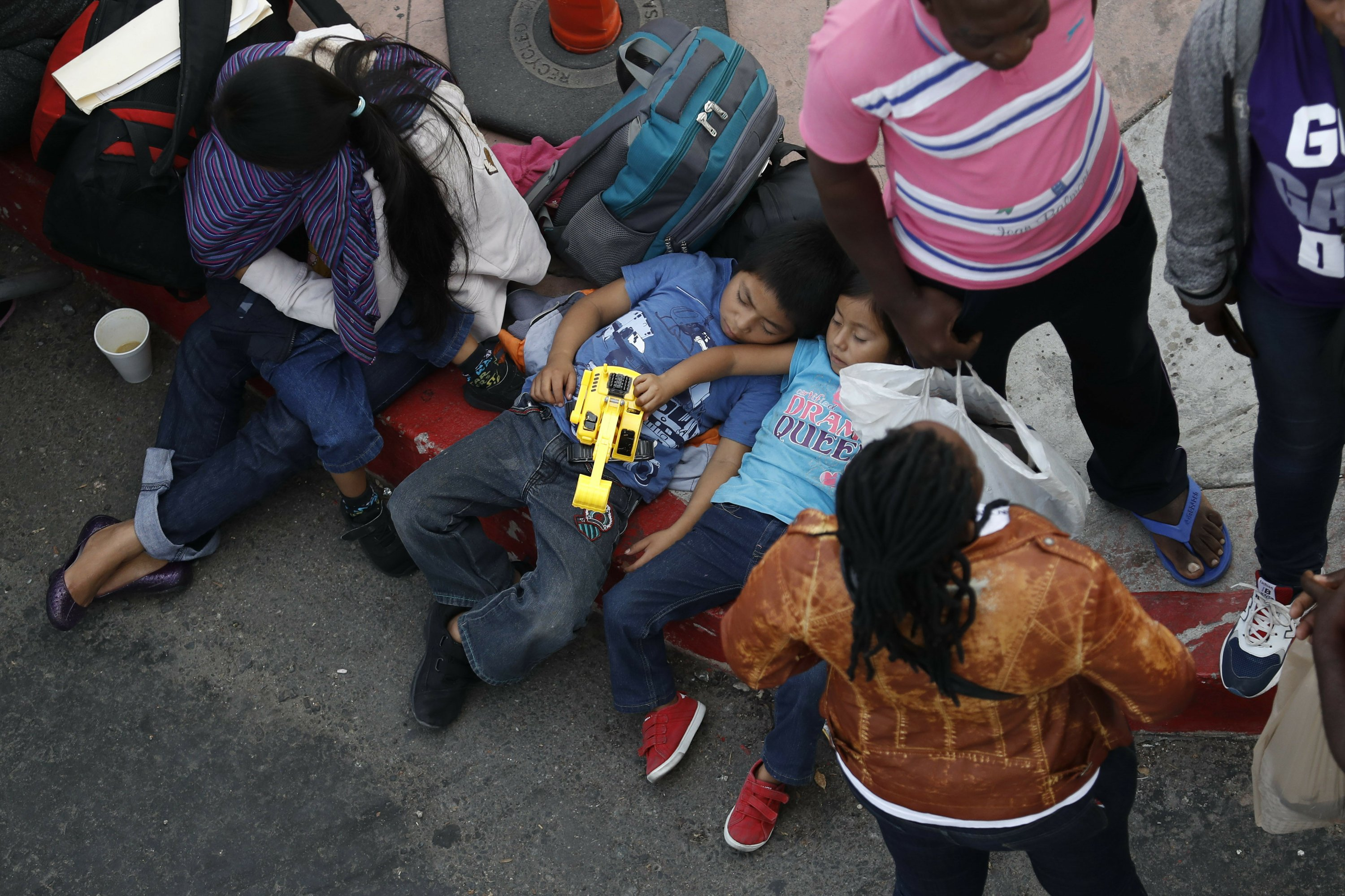 Trump's new asylum rules go into effect, and opponents sue