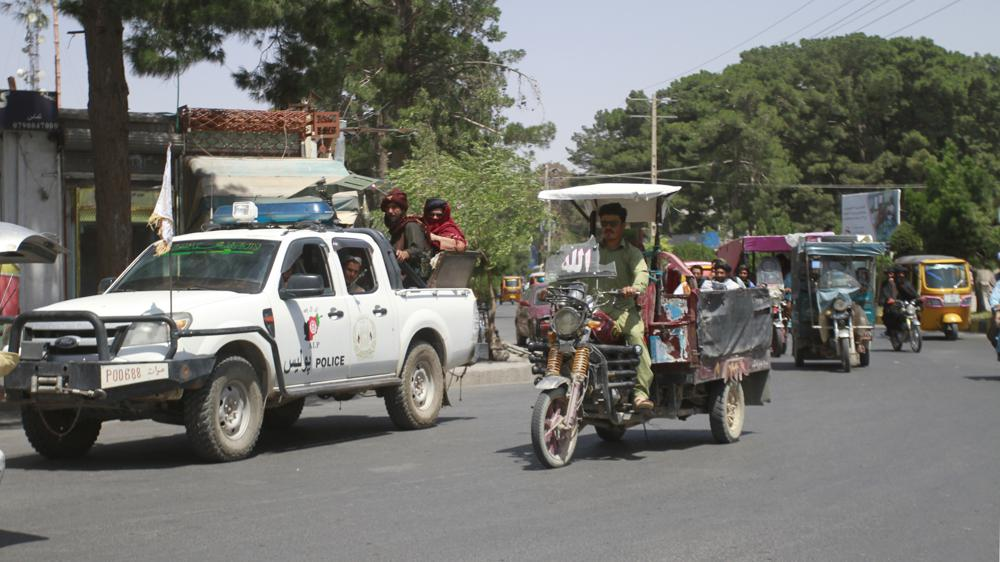Members of the Taliban, left, drive with other motorists through city of Herat, Afghanistan, west of Kabul, Saturday, Aug.  14, 2021, after the province was taken from the Afghan government.  (AP Photo/Hamed Sarfarazi)
