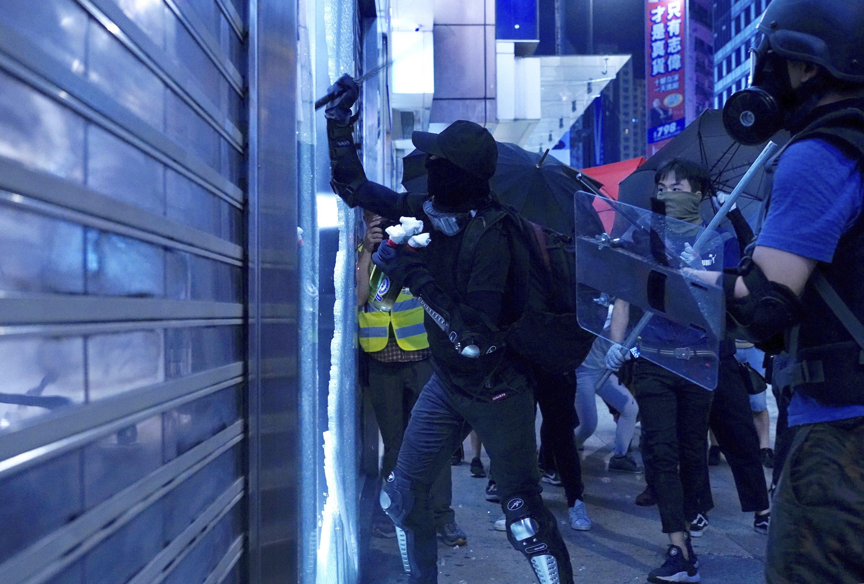 Hong Kong's leader says mask ban necessary to quell violence