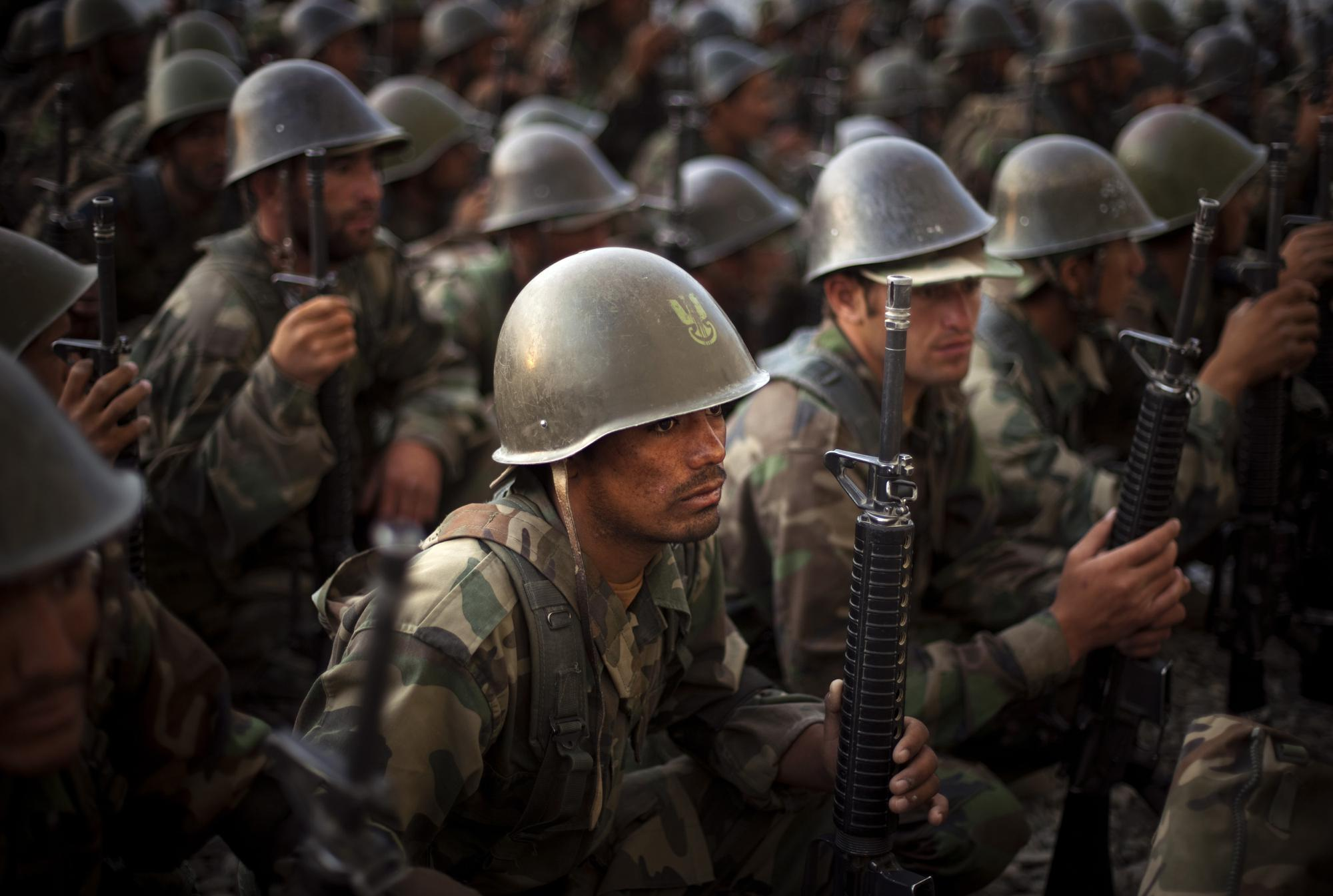 Afghan National Army recruits listen to the explanations of their instructor during a training session at the Kabul Military Training Center in Afghanistan, Sunday, July 19, 2009. (AP Photo/Emilio Morenatti)