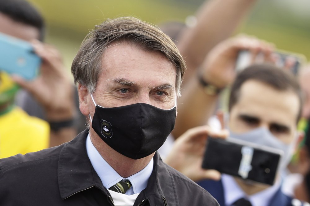 Brazil's President Bolsonaro, wearing a face mask, confirms he tested positive for COVID-19
